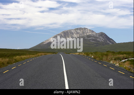 open road at Errigal mountain donegals highest peak against a blue sky between dunlewey and letterkenny - Stock Photo