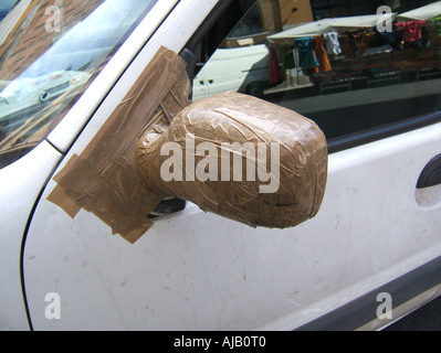 Car Side Mirror Repaired With Adhesive Tape Stock Photo