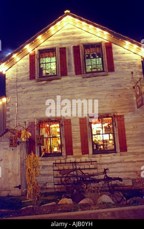 A rustic, shuttered building used as a country store, inside a quaint little shopping village in Utah USA, seen - Stock Photo