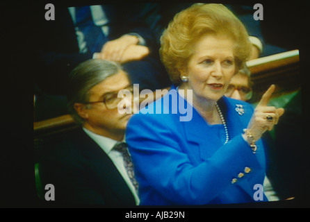 Prime Minister Margaret Thatcher seen on TV wagging a finger during exchanges at the dispatch box with Labour opposition - Stock Photo
