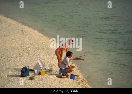 woman searches for seashells sanibel captiva islands southwest florida - Stock Photo