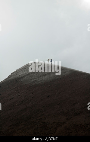 Hikers near the Smoke and steam emitted from Torre di Filosofo at 2920 meters - Stock Photo