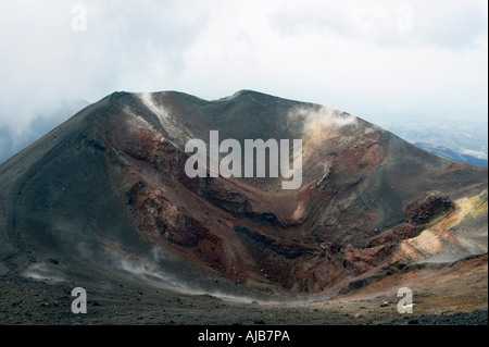 Smoke and steam emitted from Torre di Filosofo at 2920 meters erupted 2003 on the Southern slopes of Mount Etna - Stock Photo