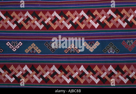 Bhutanese brocaded fabric with silk brocading Woven on a hip strap loom Bhutan - Stock Photo