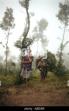 Dawn encounter with 2 Javanese women on the slopes of Gunung Mount Merapi nr Selo Java Indonesia - Stock Photo