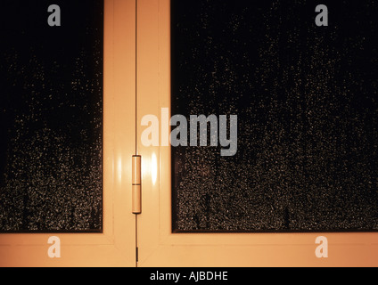 raindrops on window from inside - Stock Photo