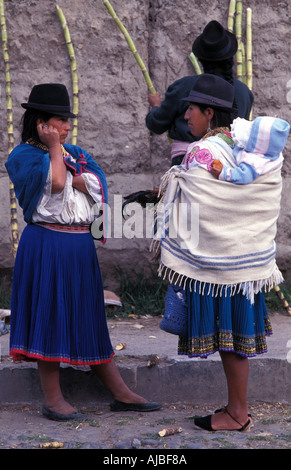 Otavaleñas at market Otavalo is one of Ecuador s most popular tourist destinations not least for its market - Stock Photo