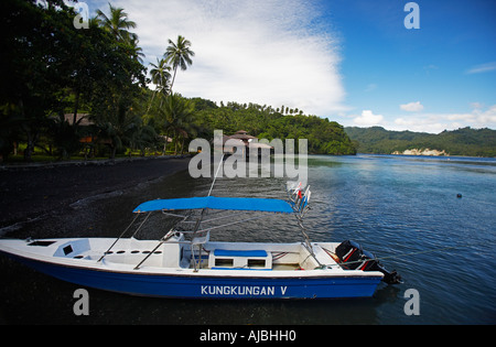 SCUBA Diving boat in Kungkungan Bay Resort Lembeh Straits Sulawesi Indonesia - Stock Photo