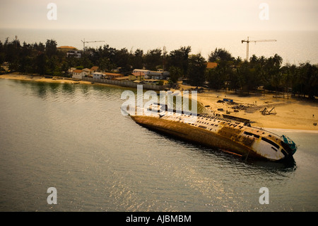 A View of the Bay with and Old Shipwreck on its Side - Stock Photo