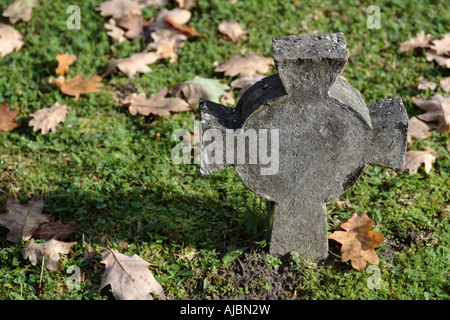 Celtic Cross Headstone in a Church Cemetery - Stock Photo