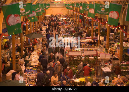 Looking down from above at people shopping in the indoor Pannier Market lit up at Christmas in Barnstaple North - Stock Photo