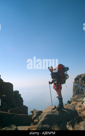 Hiker Standing Atop Giant's Castle - Stock Photo