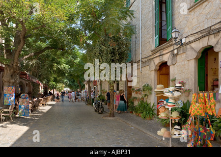 Shops on the main street in the centre of the old town, Valldemossa, West Coast, Mallorca, Spain - Stock Photo