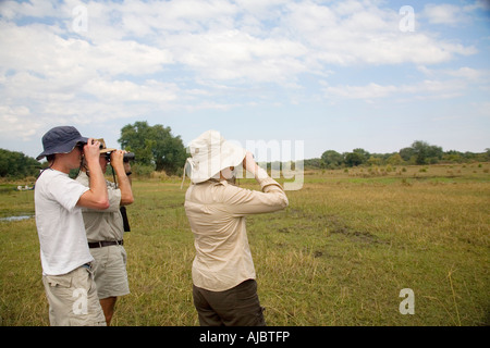 Binoculars And A Safari Hat On A White Background