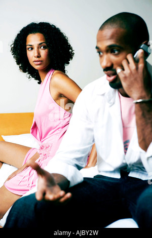 African Couple - Man on Mobile Phone - Stock Photo