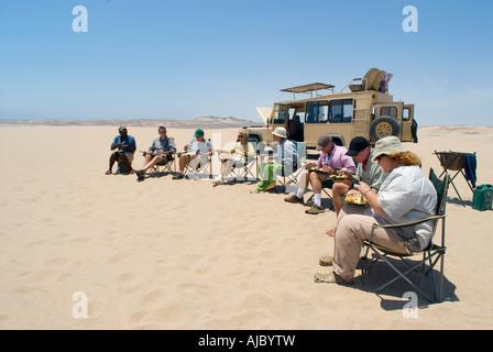 Tourists Eating on a Desert Safari - Stock Photo