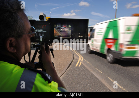 A Speed Safety Camera enforcement officer checks on speeding cars in a 30 limit area - Stock Photo