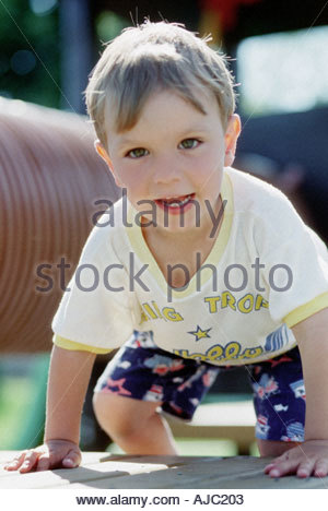 Little Boy Climbing on The Playground - Stock Photo
