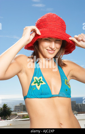 Woman in a Bikini and a Red Beach Hat - Posing - Stock Photo