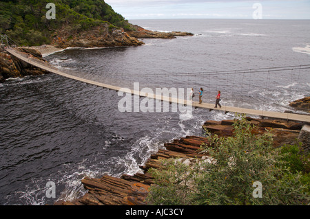 People Crossing the Pedestrain Bridge over Storms River. - Stock Photo