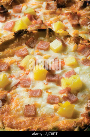 pizzas with cheese and pineapple cooked unitl golden brown often ordered from a take away or Italian restaurant - Stock Photo