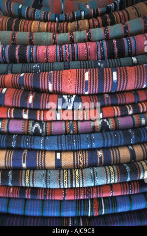 A stack of colourful textiles being sold in Calle Santander Panajachel A popular tourist purchase Guatemala - Stock Photo
