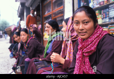 A row of friendly seated women at Keylong Himachal Pradesh foothills of the Himalayas waiting for transport India - Stock Photo