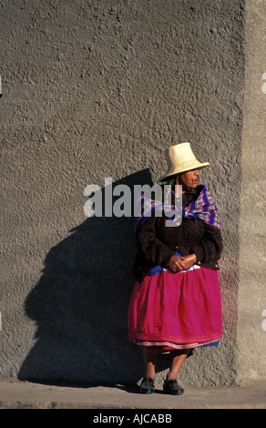 Brightly dressed Quechua woman from Caraz at the local morning market Calleyon de Huaylas Northern Peru - Stock Photo