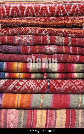 Stack of Andean fabrics from Peru and Bolivia As sold in the markets of La Paz Bolivia and Cuzco and Pisac Peru - Stock Photo