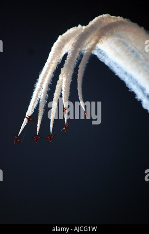 Red Arrows burst forth - Stock Photo