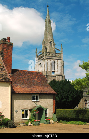 Woolpit parish church spire with cottage - Stock Photo