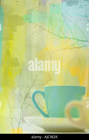 photo illustration of a pair of coffee cups in winter setting with branches - Stock Photo