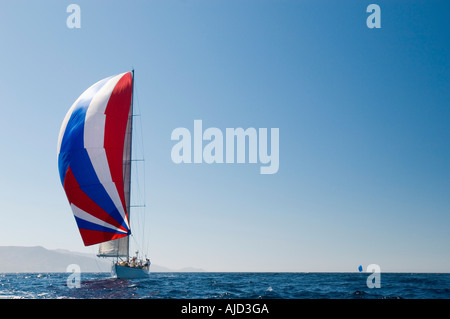 Yacht on ocean with full sail, front view - Stock Photo