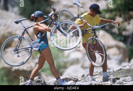 Young Couple on Cycle Trip - Stock Photo