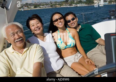 Family on Sailboat - Stock Photo