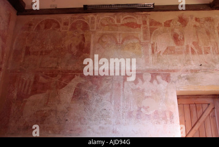 Early medieval wall paintings in St Botolphs Church, Hardham, West Sussex. - Stock Photo
