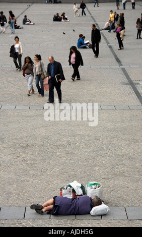 Homeless woman on the plaza in front of the National Museum of Modern Art known as Centre Georges Pompidou in the - Stock Photo