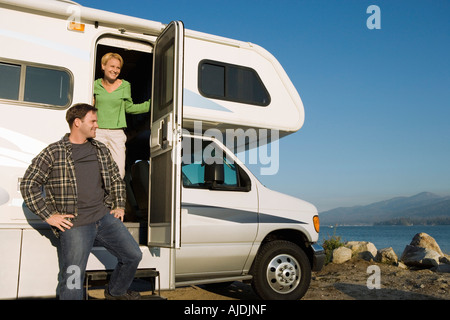 Couple in RV at lakeshore - Stock Photo