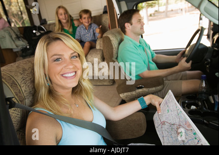 Family in RV on Summer Road Trip - Stock Photo