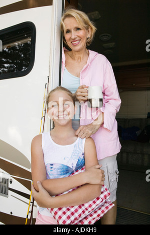 Mother and Daughter in Doorway of RV - Stock Photo