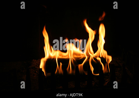 Fireplace with a burning log - Stock Photo