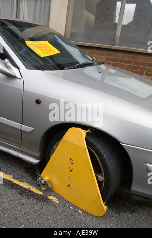 Wheel Clamp,around car tyre, car wheel, immobilised, unable to be moved. - Stock Photo