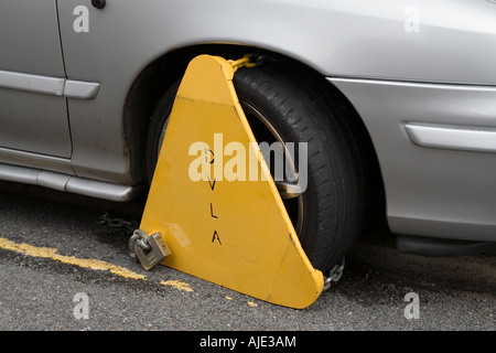 Wheel Clamp,around car tyre, car wheel, immobilised, unable to be moved.painting road - Stock Photo