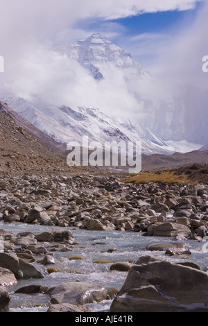 North face of Mt Everest in clouds seen from a Himalayan small river. - Stock Photo