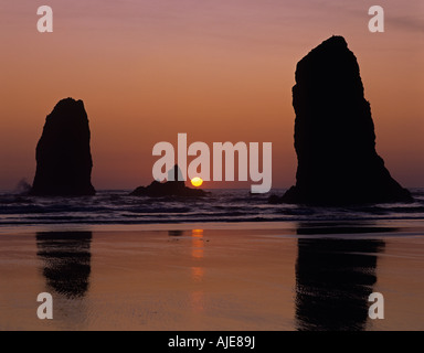 Silhouetted rock formations the Needles at sunset Cannon Beach Northern Oregon Coast Oregon State USA - Stock Photo
