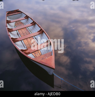A view of boat moored off the Castle boat house jetty at Crom Estate County Fermanagh Northern Ireland - Stock Photo