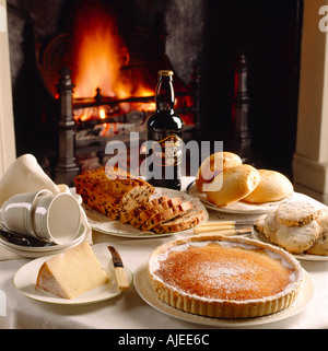 A Yorkshire tea of Old Peculiar fruit cake Scarborough muffins and Fat Rascals Yorkshire curd cheesecake - Stock Photo