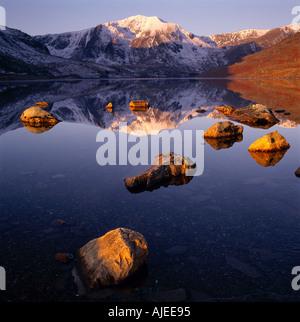 Y Garn reflected in the still waters of Llyn Ogwen Carneddau Wales - Stock Photo