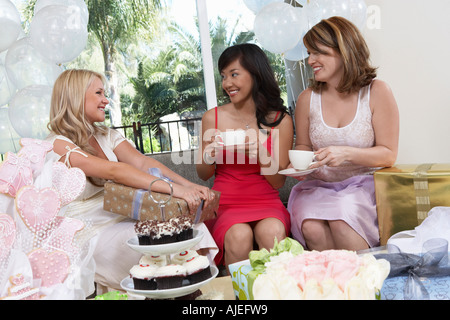 Bride talking to Friends, Giving Gifts at Bridal Shower - Stock Photo