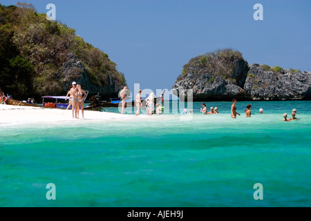 Visitors enjoy a dip in warm tropical waters around popular Ko Poda island off Ao Nang Thailand - Stock Photo